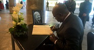 Amb. John Ejinaka CG Consulate of Nigeria signing the condolence register of Late Chancellor Helmut Schmidt